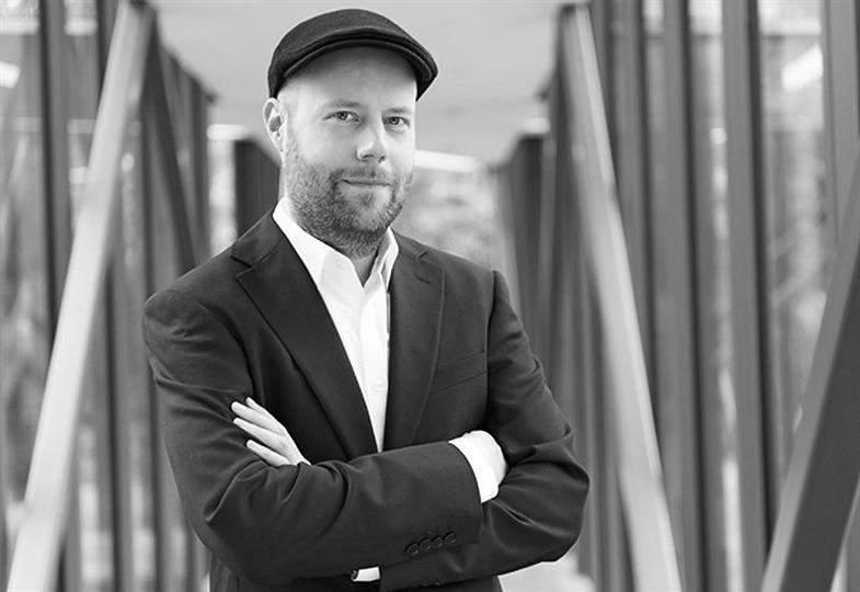 Was bedeutet der Deutsche Friedenspreises für Fotografie für Osnabrück? Portrait Nils-Arne Kässens, Direktor des Museumsquartiers Osnabrück